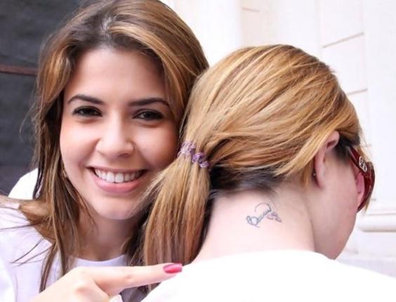 A carioca Nathalia Vieira enviou foto da tatuagem que fez em homenagem a Claudia Colucci, a Cacau do Big Brother Brasil 10